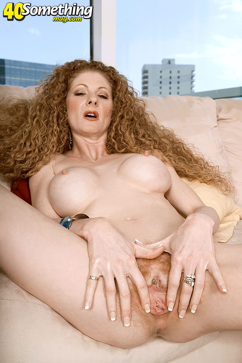 A latin woman with red curly hairy